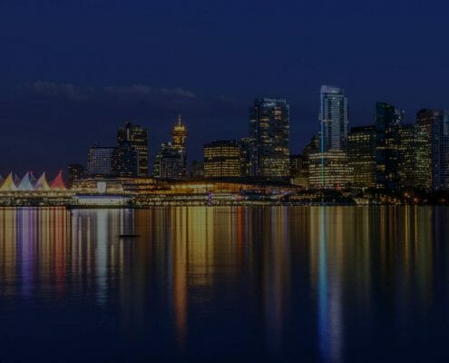 vancouver skyline at dusk as seen from stanley park british columbia canada