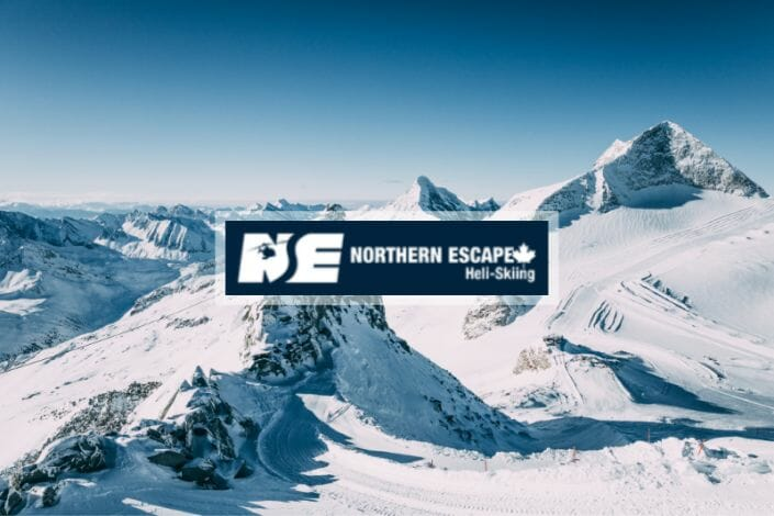 Northern Escape Heli-Skiing featured image of snow covered mountains.