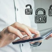 Man holding cell phone with unlock-lock-unlock draw over it