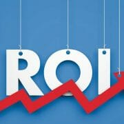 """Strings holding the letters that spell out """"ROI"""" with red upward trend arrow"""