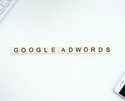 Google Adwords spelled out with Scrabble Letters - next to smart phone
