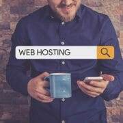 guy holding phone searching for web hosting