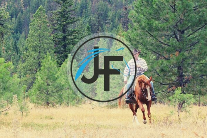 Jonathan Field Horsemanship featured image of a cowboy on a horse in a clearing.