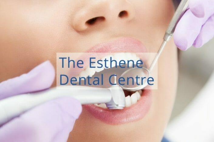 The Esthene Dental Centre featured image showing dentist checking a patient's teeth.